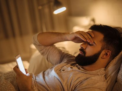 Worried young man reading bad news on smart phone