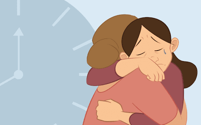 Two friends hugging while one friend is shown, crying