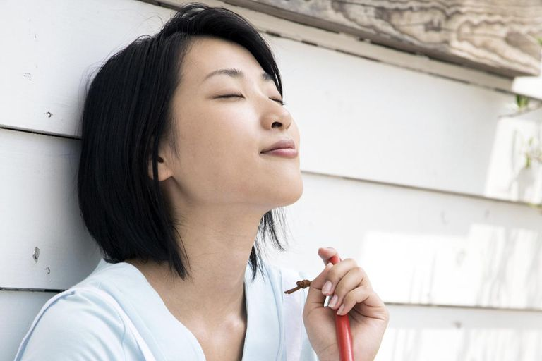 A woman having a break taking deep breaths to reduce stress