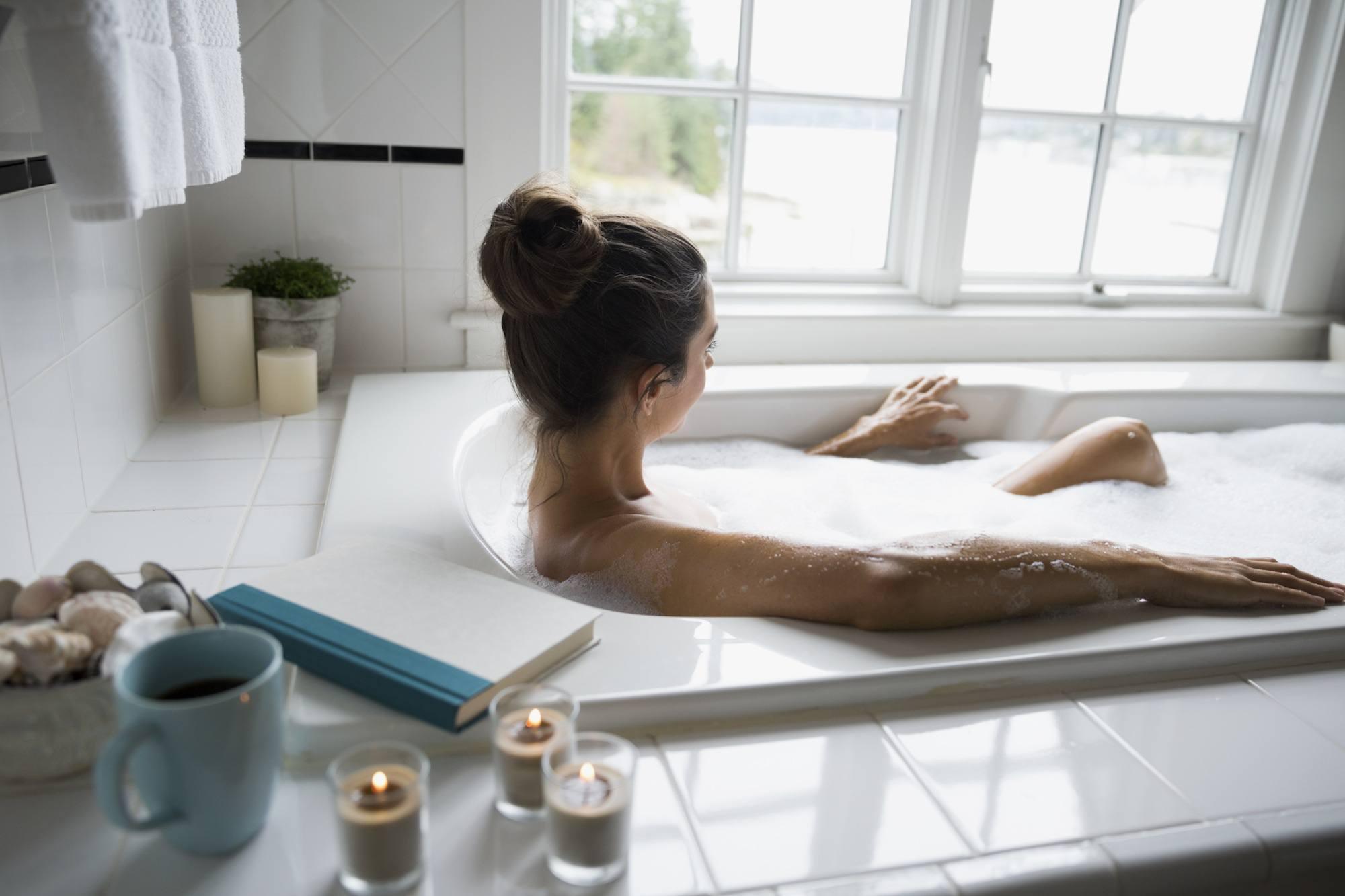 Woman enjoying bubble bath