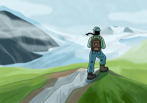 Person on top of a mountain looking ahead