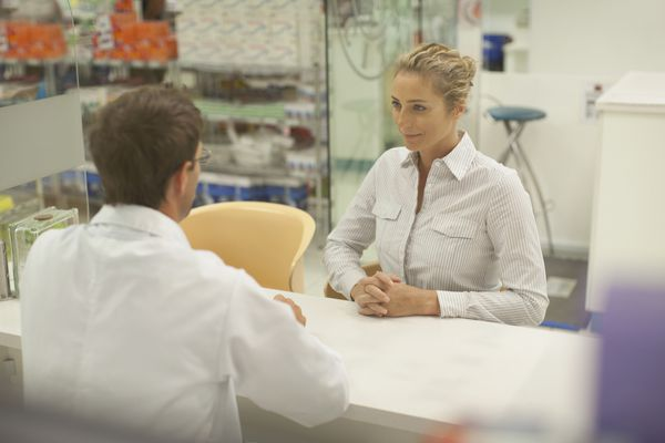 Pharmacist consulting with patient