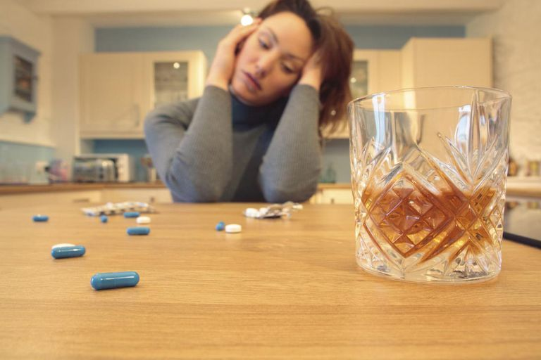 Woman With Alcohol and Pills