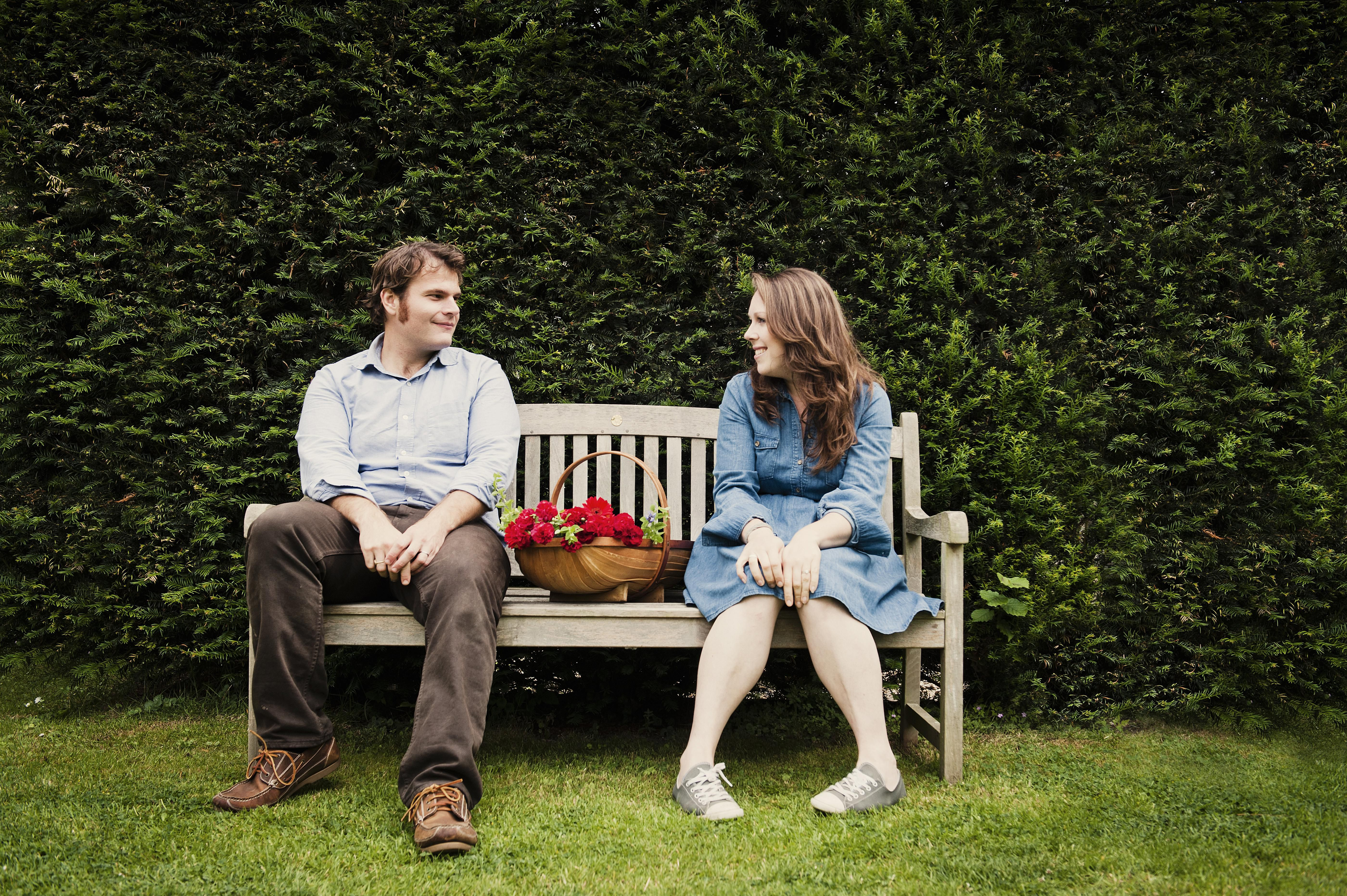 Couple chatting on a park bench