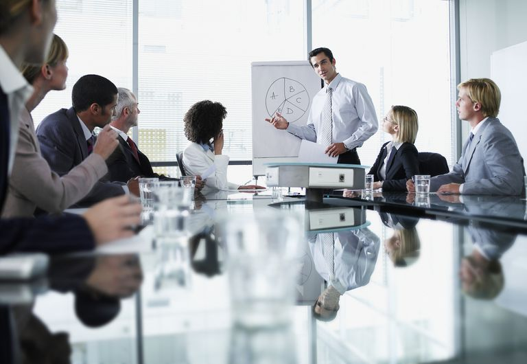 Businessman giving a presentation in a conference room of colleagues