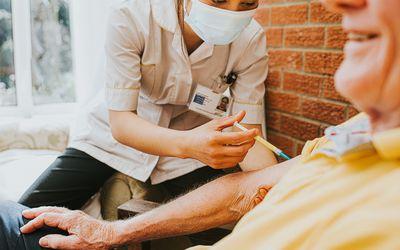 older man getting a vaccine
