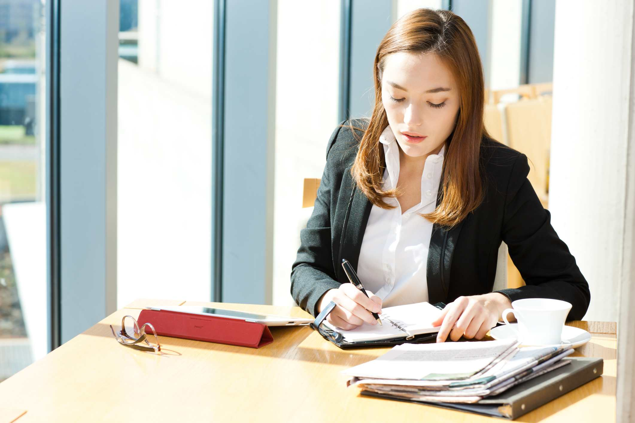stressed woman writing in day planner