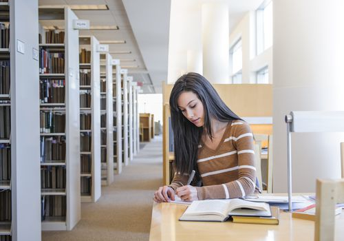 Student studying in a school library