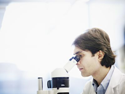 Researcher conducting a double-blind study