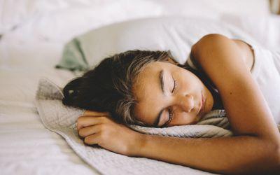 Girl sleeping on bed in morning