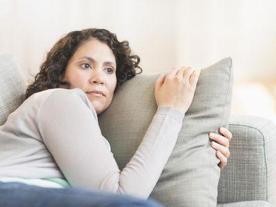 worried woman on sofa
