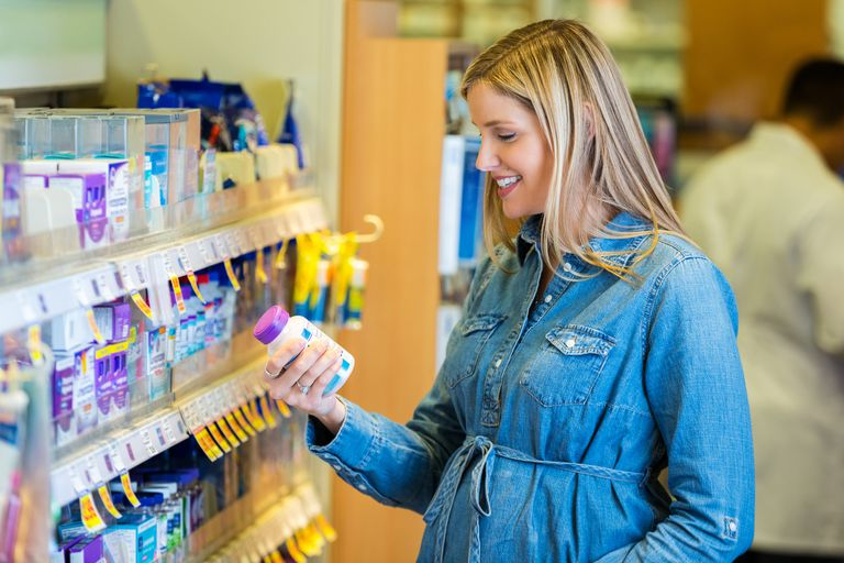 Woman deciding whether to try a new prenatal vitamin