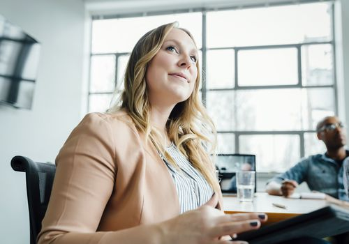 Businesswoman listening in meeting
