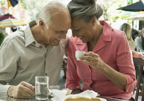 A senior married couple enjoys breakfast together.