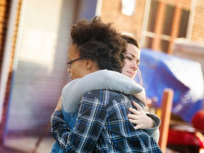 Young women forgiving each other with a hug