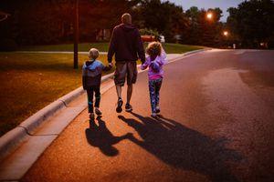 family walking at night