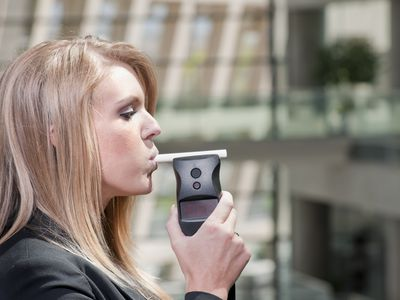 Woman Taking Alcohol Breath Test