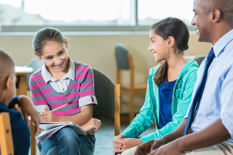 Child psychologist with young clients