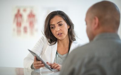 Female doctor counseling patient on anti-anxiety medications