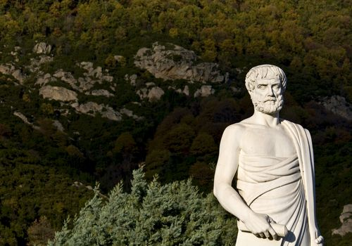 Aristotle statue with foliage located in Stageira, Greece
