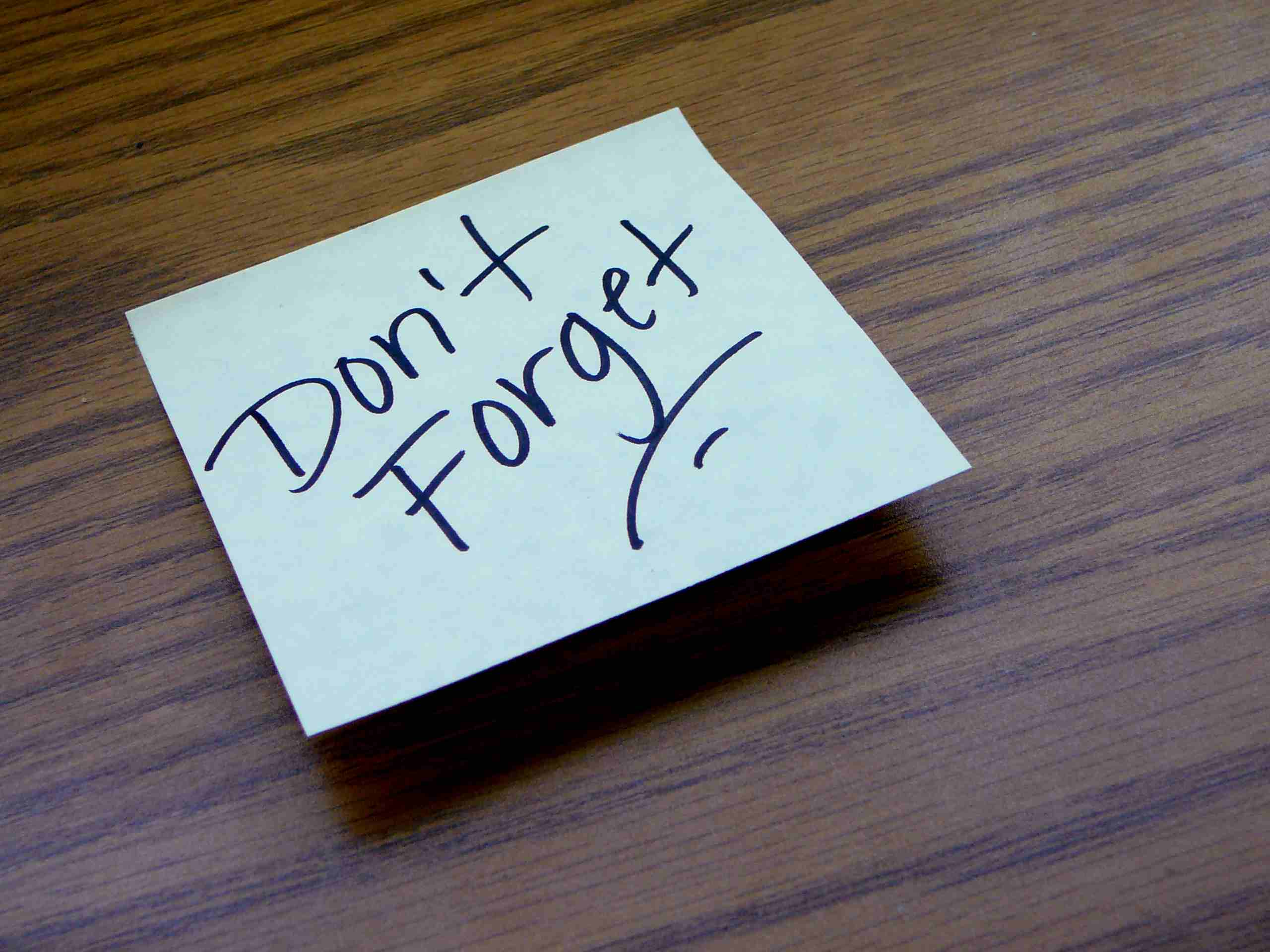 sticky note with don't forget written on it