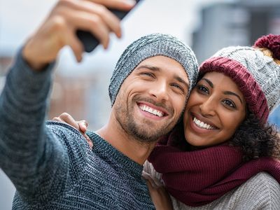 mixed race couple taking a selfie