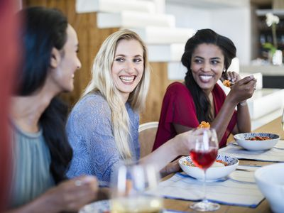 three women eating and laughing