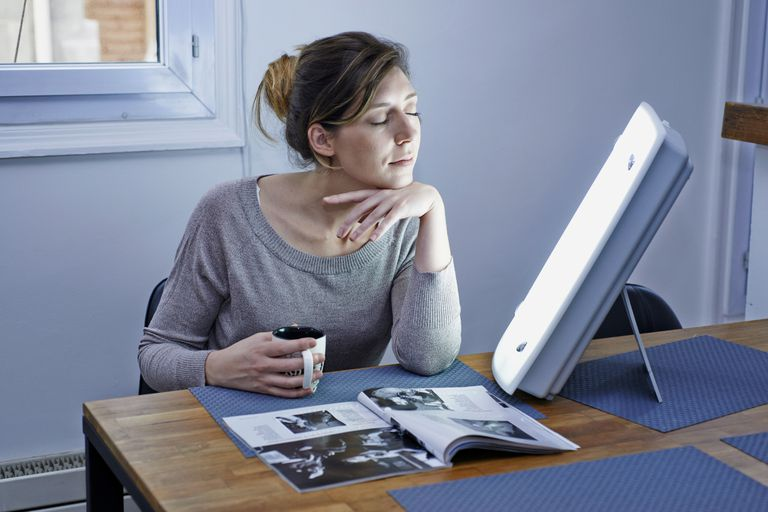 woman with light therapy lamp