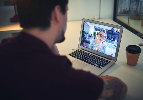 Person in a video call with their therapist.