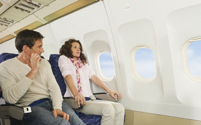 a woman panicking on a plane