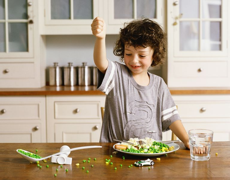 Boy flinging peas
