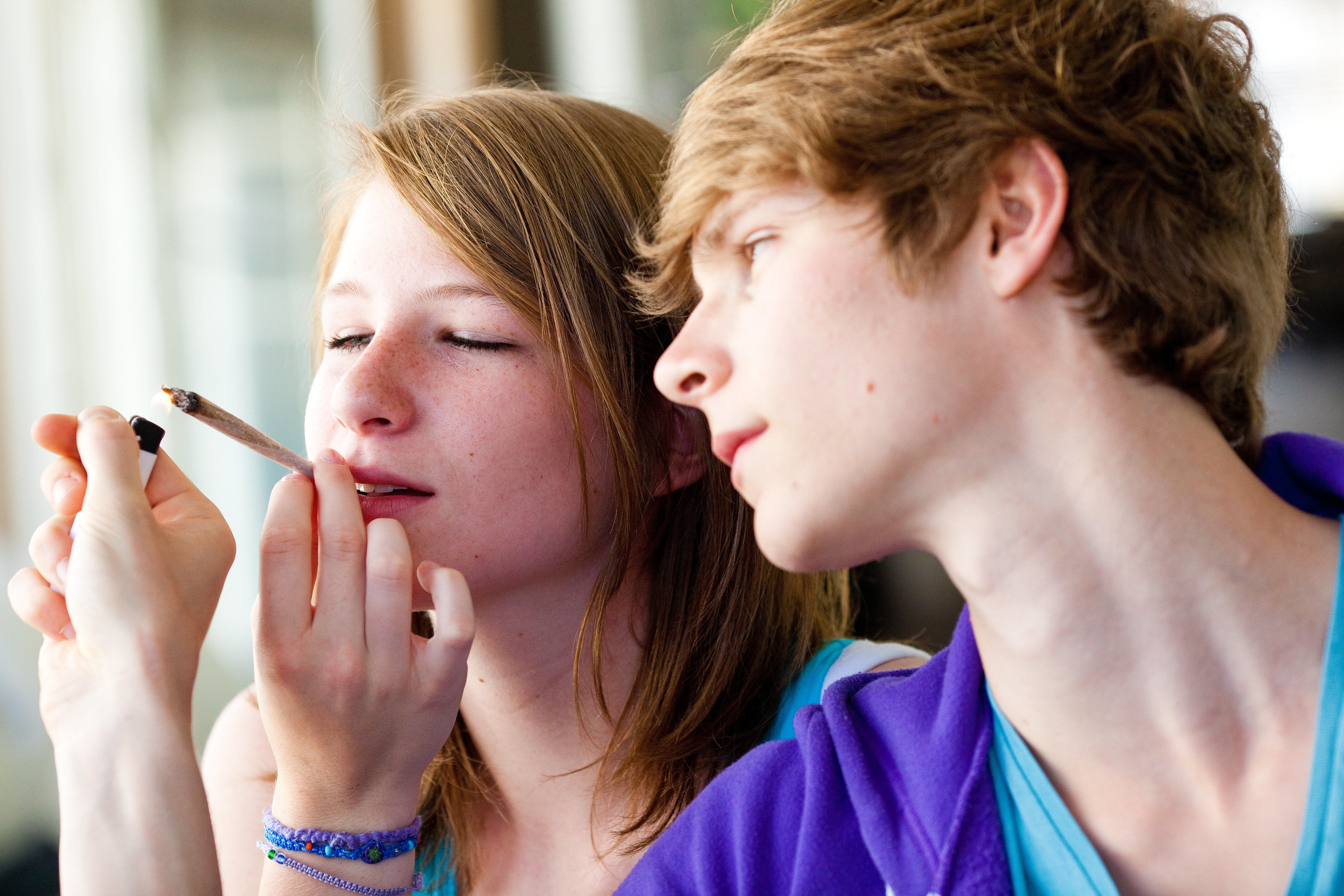 Young teenagers smoking marijuana which contains THC