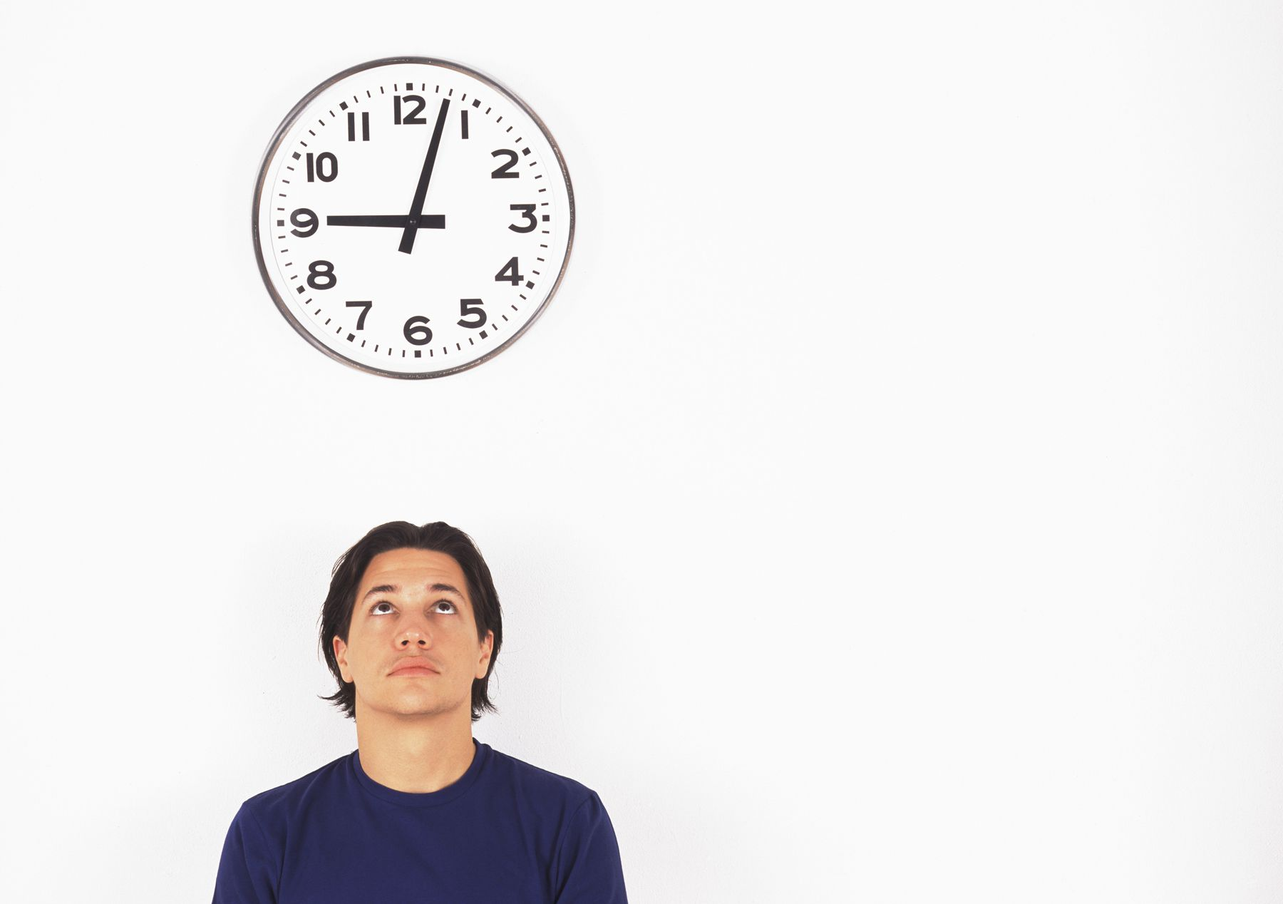 Man waiting under clock