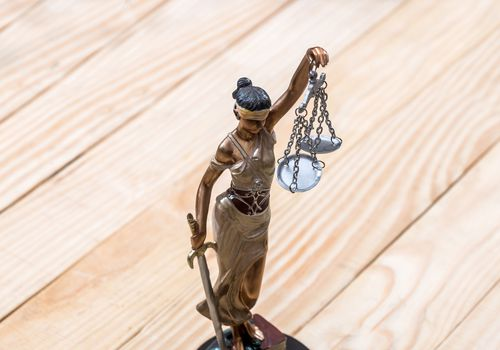 A figure of lady justice holding up scales