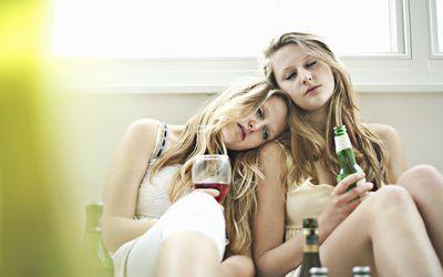 Drunken teenage girls dozing together
