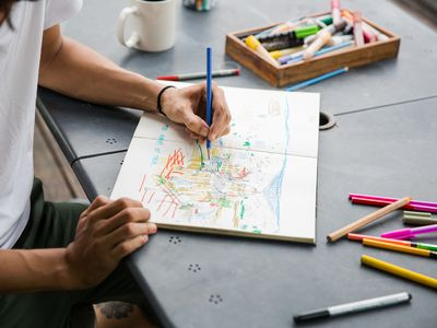Man sketching with colored pencils