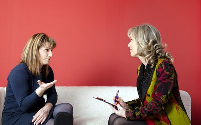 clinical psychologist talking with woman