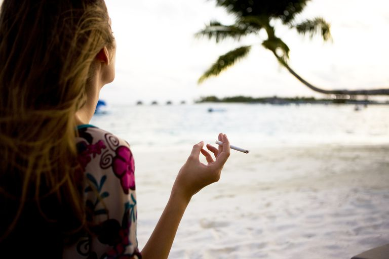 woman smoking on the beach