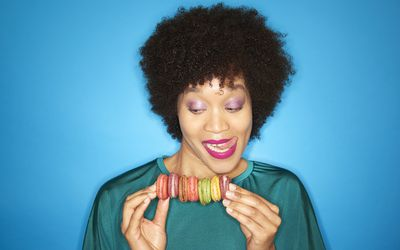 woman with colourful macarons