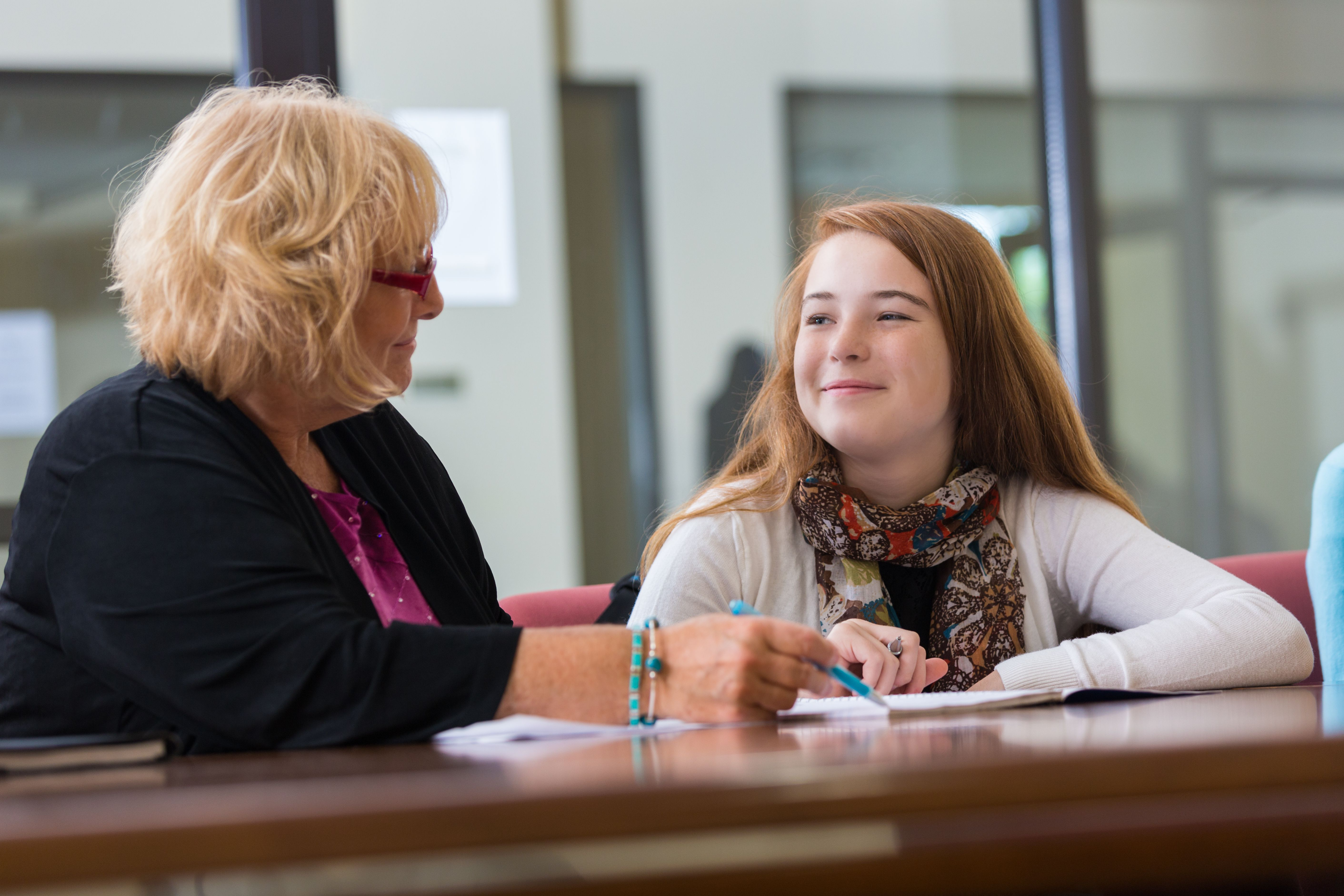 Preteen student meeting with school counselor or therapist