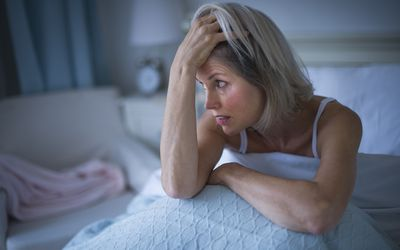 Woman in bed suffering from insomnia