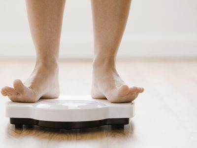 feet of a person weighing themself on a scale
