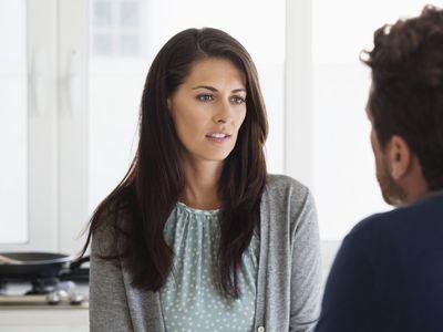 Serious woman talking to a man