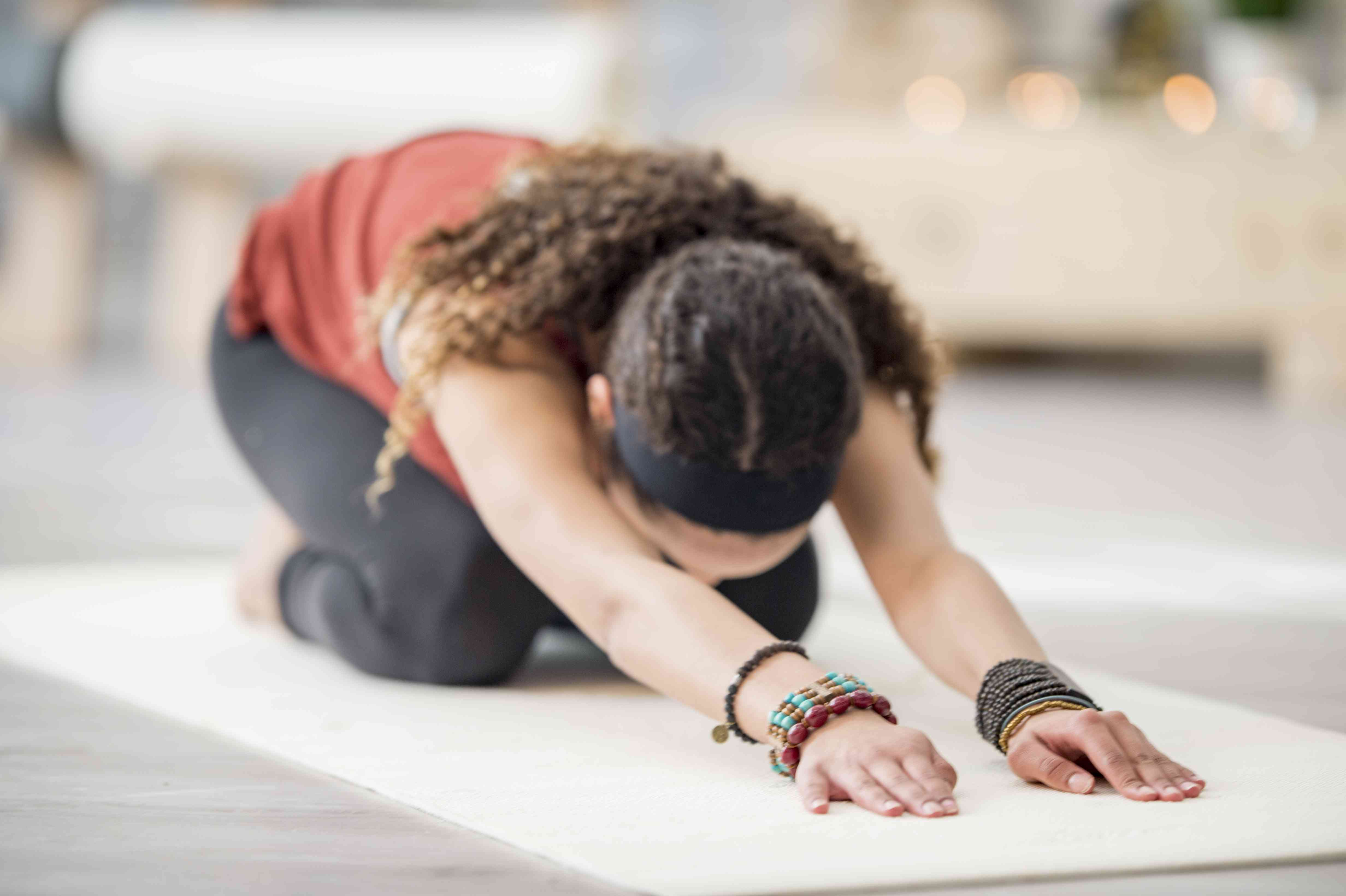 Teen girl doing a yoga exercise for stress management