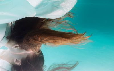 Woman underwater with mirrored perspective