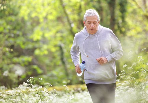 older man jogging outdoors
