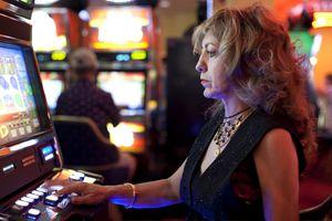 Woman using slot machine