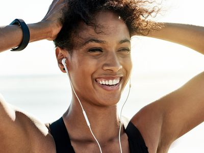Woman with big smile during exercise.