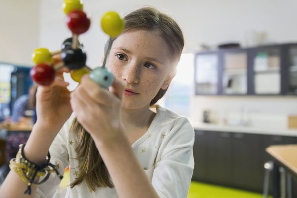 child looking at a molecular model