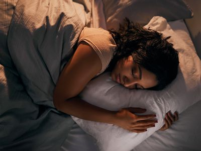 High angle shot of a beautiful young woman sleeping in her bed at home during the night